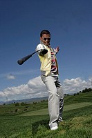 Portrait of a young man posing with a golf club (thumbnail)