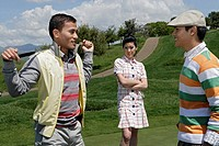View of two men having discussion during a golf game