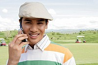 Portrait of a young man talking on a cellphone
