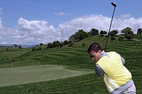 View of a man playing golf