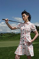 Young woman holding a golf club