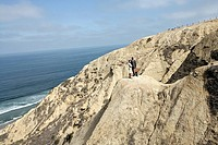 View of a man and a woman standing on a cliff (thumbnail)