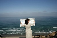View of a woman reading a map