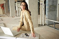 View of businesswoman with her laptop