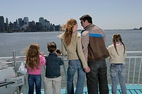 Family of five on the bow of a ferryboat