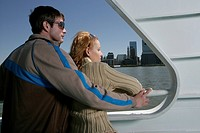 Couple standing together on a boat