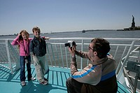 Man recording children on a boat