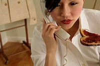 Woman over telephone, close-up