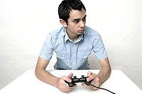 View of a teenage boy holding a control