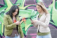 View of two women with cellphone