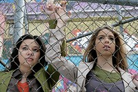 View of two women near a fence