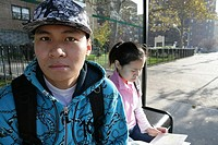 Teenagers 15-17 sitting on bench (thumbnail)