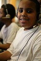 Boys 11-13 wearing headphones, portrait