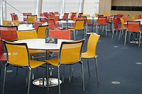 Chairs and tables arranged in office canteen