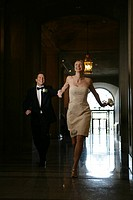 Couple running down a corridor