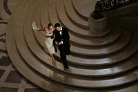 Couple walking down a staircase