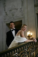 Mature couple on staircase looking at camera