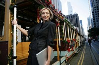 Mature business woman on a trolley (thumbnail)