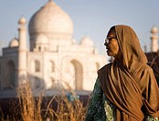 Woman and Taj Mahal in background, Agra. Uttar Pradesh, India