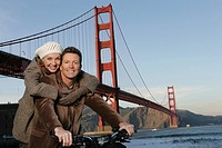 Mature couple on a bike