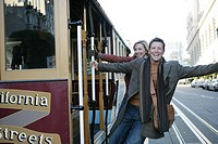 Mature couple on a trolley car (thumbnail)