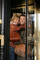 Mature couple inside revolving doors