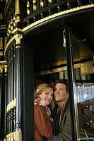Mature couple in between revolving doors