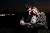 Mature couple embracing at night (thumbnail)