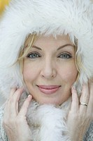 Close-up of blond woman wearing a fur hat (thumbnail)