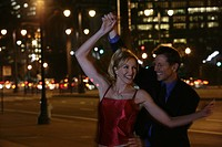 Mature couple dancing in the streets