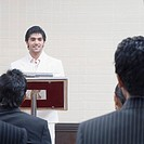Businessman giving presentation in a conference room