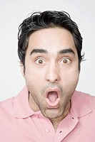 Portrait of a young man looking surprised