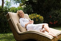 A woman reclining on a sun lounger