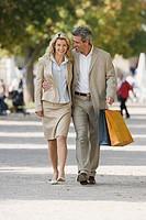 A mature couple walking