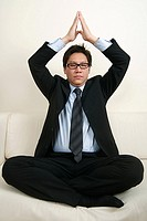 A businessman meditating