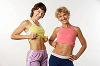 Mother and daughter show their flat stomachs