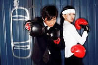 Young office man and woman boxing