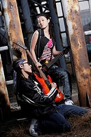 Young man and woman playing guitar