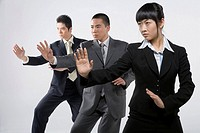 three business persons practicing Chinese Kungfu