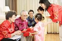 Junior giving present to eldership