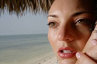 Close-up of young woman hugging man at beach