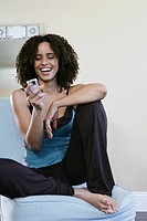 Woman smiling looking at a cellphone