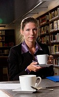 Portrait of a businesswoman holding tea cup in an office