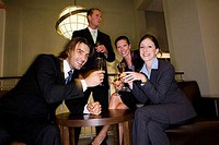 Portrait of cheerful business people celebrating in an office