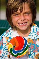 Portrait of a cheerful boy with lollipop