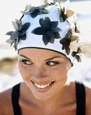 A woman wearing swimming cap with flowers
