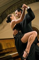 Low angle view of a young couple dancing (thumbnail)