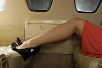 Low section view of a woman sitting in a private airplane