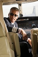 Pilot sitting in a private airplane