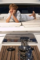 Teenage boy relaxing on boat